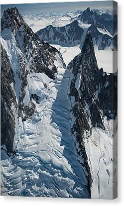 Icyvertigo Canvas Print by Roger Clifford