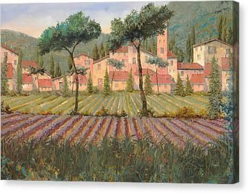 Il Villaggio Tra I Campi Di Lavanda Canvas Print by Guido Borelli