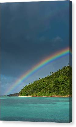 Incredible Rainbow Over An Islet Of Ofu Canvas Print by Michael Runkel