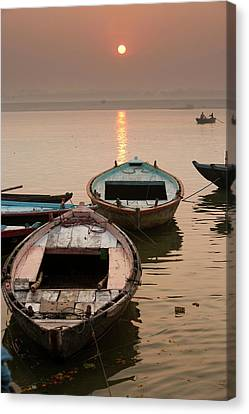 India, Varanasi Boats On The Ganges Canvas Print by Gavriel Jecan
