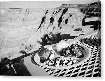 indian buffet food at guano point on the edge of the grand canyon home of the hualapai nation Arizon Canvas Print by Joe Fox