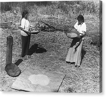 Indian Women Winnowing Wheat Canvas Print by Underwood Archives Onia