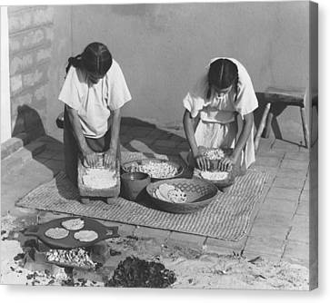Making Canvas Print - Indians Making Tortillas by Underwood Archives