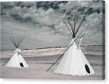 Infrared Image Of Native American Tipis Canvas Print by Roberta Murray