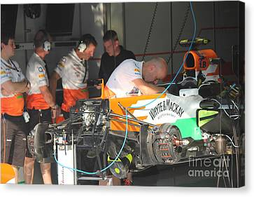Inside The Force India Garage Canvas Print by David Grant