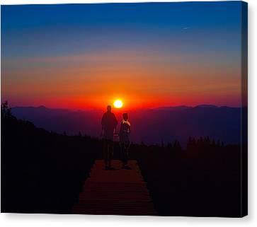 Into The Sunset Together Canvas Print by John Haldane