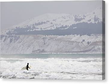 Into The Winter Surf Canvas Print by Tim Grams