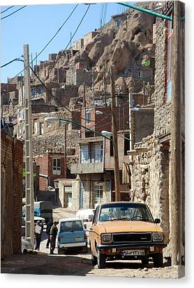 Iran Kandovan Cars And Wires Canvas Print by Lois Ivancin Tavaf