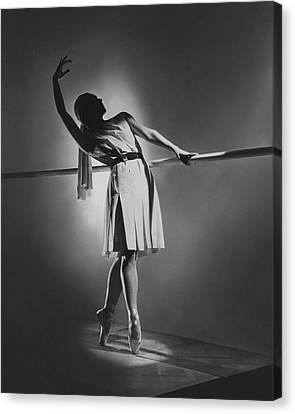 Ballet Dancers Canvas Print - Irina Baronova At The Barre by Horst P. Horst