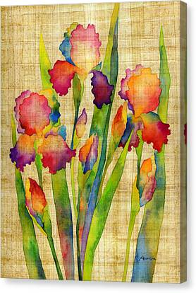 Iris Elegance On Yellow Canvas Print by Hailey E Herrera