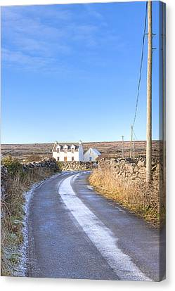 Irish Cottage On The Aran Islands Canvas Print by Mark E Tisdale