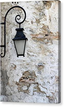 Iron Lantern On A Old Brick Wall Canvas Print by Kamen Zagorov