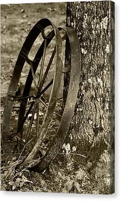 Iron Wheel Canvas Print by Linda Segerson