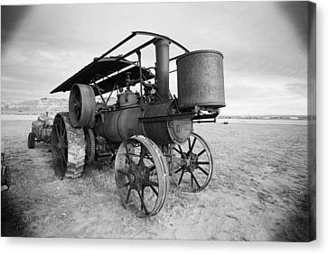 Iron Wheels And Steam Canvas Print by HW Kateley