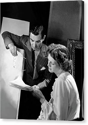 Irving Berlin Looking At Papers With His Wife Canvas Print