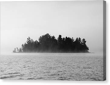 Island In The Mist Canvas Print by Steven Clipperton