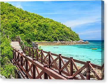Island Paradise Beach Canvas Print by Niphon Chanthana
