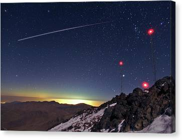 Iss Crossing The Night Sky Canvas Print by Babak Tafreshi