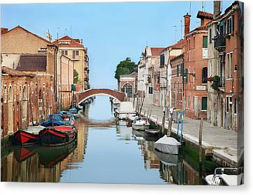 Italy, Venice View Of Boats And Homes Canvas Print