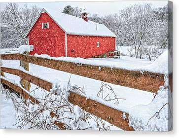 Red Barn In Snow Canvas Print - It's Snowing by Bill Wakeley