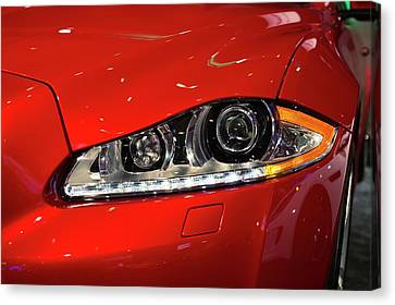 Jaguar Xjr Headlights Canvas Print by Jim West