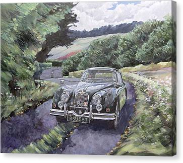 Jaguar Xk150 Cruising Canvas Print by Clive Metcalfe
