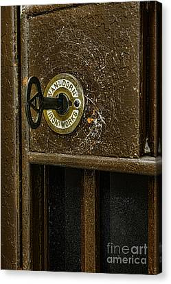 Jail Cell Door Lock  And Key Close Up Canvas Print by Paul Ward