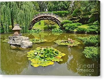 Japanese Garden With Moon Bridge And Lotus Pond With Koi Fish. Canvas Print by Jamie Pham