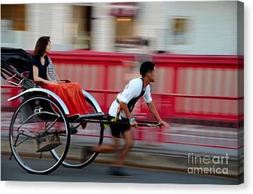 Japanese Tourists Ride Rickshaw In Tokyo Japan Canvas Print by Imran Ahmed