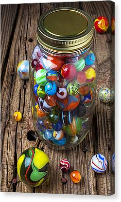 Jar Of Marbles With Shooter Canvas Print