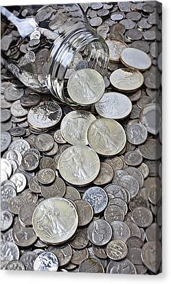 Jar Spilling Silver Coins Canvas Print