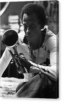 Jazz Musician Miles Davis Looking At His Trumpet Canvas Print