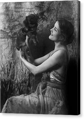 Jeanne Eagels Lifting Up A Small Dog Canvas Print