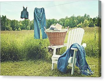 Jeans Hanging On Clothesline On A Summer Afternoon Canvas Print by Sandra Cunningham