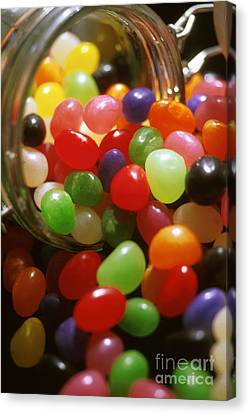 Jelly Beans Spilling Out Of Glass Jar Canvas Print by Anonymous