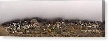 Jerome Arizona Beneath The Clouds Canvas Print by Ron Chilston