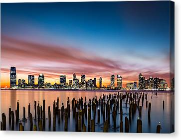 Canvas Print featuring the photograph Jersey City Skyline At Sunset by Mihai Andritoiu