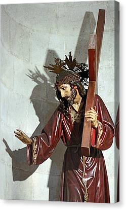 Jesus Holding His Cross Canvas Print by Munir Alawi