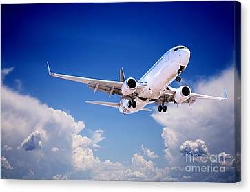 Jet Aeroplane Landing Through Gap In Stormy Sky Canvas Print by Colin and Linda McKie