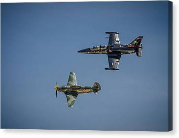 Jet Vs Plane Canvas Print by Bradley Clay