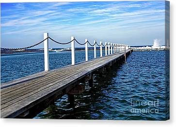 Jetty Stretching To The Ocean Canvas Print by Kaye Menner