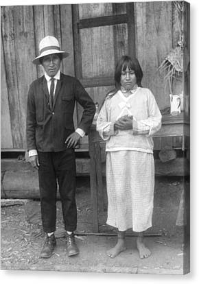 Jivaro Headhunter And His Wife Canvas Print by Underwood Archives