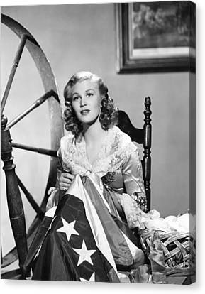 Publicity Shot Canvas Print - Joan Caulfield As Betsy Ross, Sewing by Everett