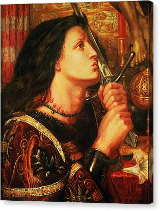 Joan Of Arc Kissing The Sword Canvas Print by Dante Gabriel Charles Rossetti