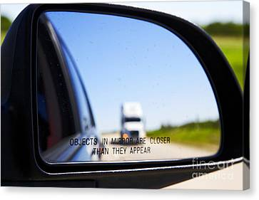 Joe Fox Fine Art - Objects In Mirror Are Closer Than They Appear With Following Semi Truck On Canadian Highway Canvas Print