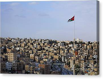 Jordanian Flag Flying Over The City Of Amman Jordan Canvas Print by Robert Preston
