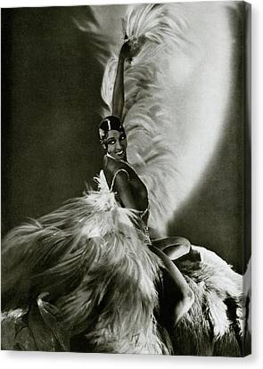 Josephine Baker Wearing A Feathered Cape Canvas Print by George Hoyningen-Huene