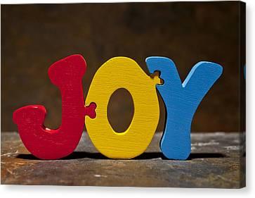 Joy Puzzle Painted Wood Letters Canvas Print by Donald  Erickson