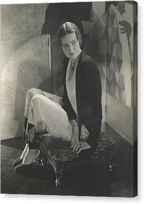 Jule Andre Sitting On An Ottoman Wearing Pajamas Canvas Print
