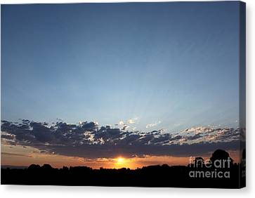 July Sunset Canvas Print by Erica Hanel